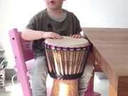 Watch free video Kid Plays The Djembe