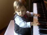 Cute Baby Boy Is Playing The Piano