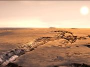Watch free video Flight over craters and canyons on Mars-3