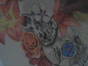 Watch free video Skulls And Flowers Tattoo Design