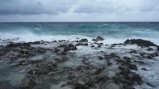 Watch free video A Choppy Sea Crashing Onto Rocks