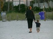 Watch free video Mother and child at the Beach