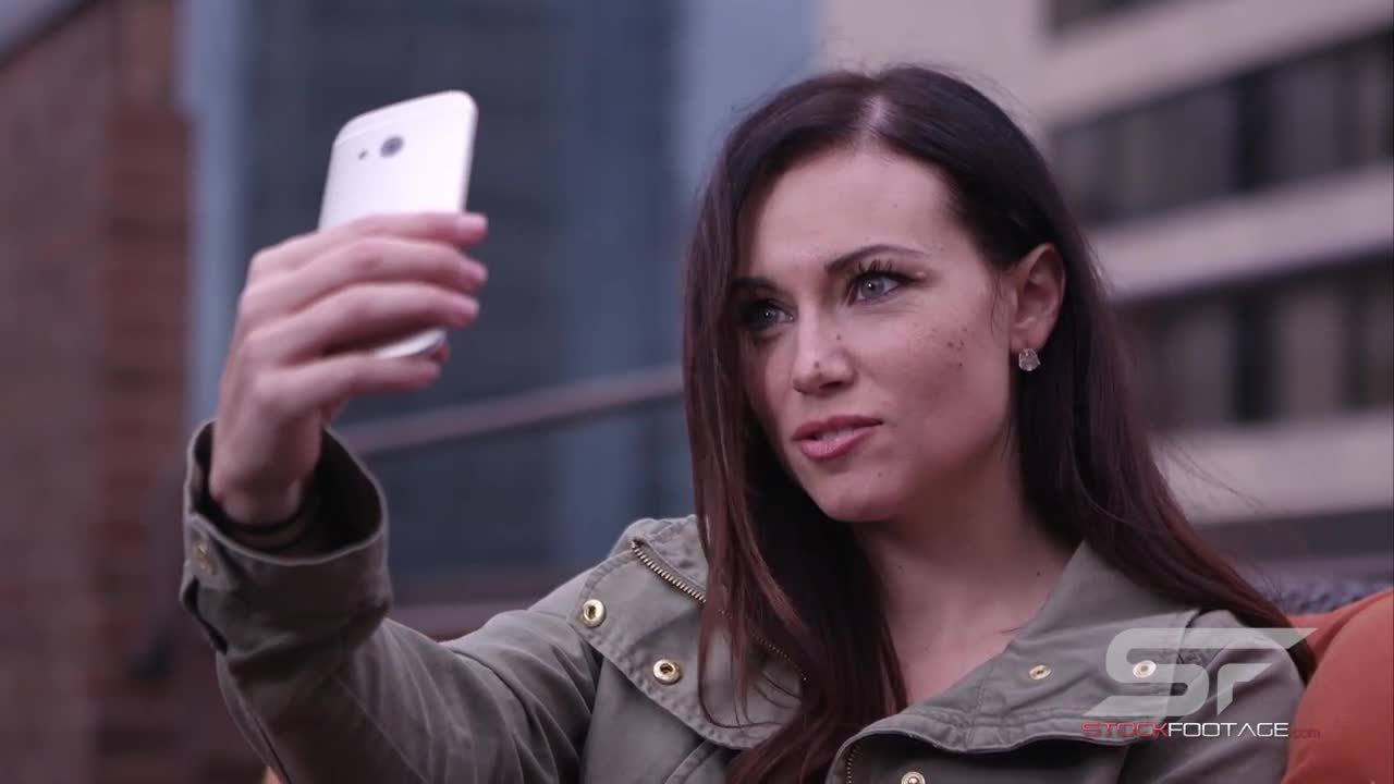 Watch free video Woman Taking Picture of Herself with Smartphone