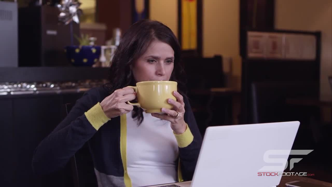 Watch free video Woman in Coffee Shop Drinking Coffee Close Up