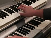 Watch free video A Musician Plays a Piano and Key Board