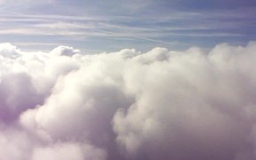 Watch free video Fly Through the Clouds