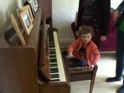 Watch free video Child Playing the Piano