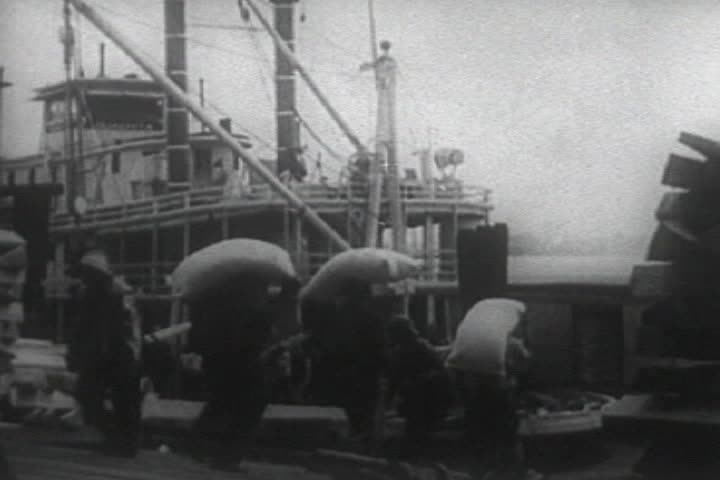 Watch free video Loading Cotton Bales On Steam Boat