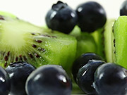 Watch free video Kiwi Fruit and Blueberries in Macro View