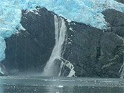 Watch free video Alaska Waterfall Crashes Into Icy Waters