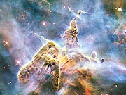 "Watch free video Zooming in on""Mystic Mountain""in the Carina Nebula"