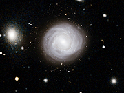 Watch free video Zooming into NGC 4921