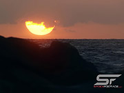 Watch free video Slow Motion Shot of Sun Setting Over the Ocean