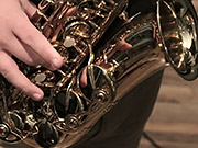 Watch free video Musician Plays A Gold Saxophone Close Up