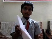 Watch free cartoon A Boy making an Origami Boat